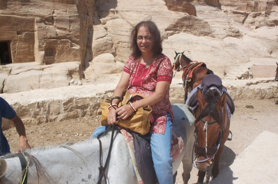 Deepshree saddled up on a horse.